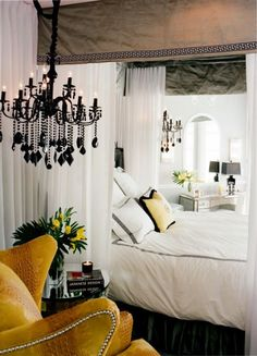 Black chandeliers as bedside lighting. Pretty...