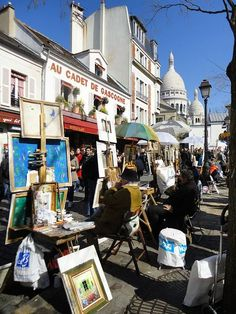 Monmartre Artist Market you won't be able to resist making a purchase or you will get cornered for a portrait by won of the street vendors