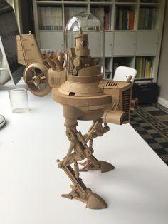 Project now has legs Steampunk Robots, Arte Robot, Modelos 3d, Cardboard Art, 3d Prints, Designer Toys, Retro Futurism, Wood Toys, Metal Art