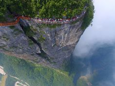 A group of people brave a sightseeing platform amidst the otherworldly quartzite sandstone columns that fill Zhangjiajie in China's Hunan Province.