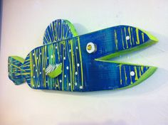 Painted fish made from recycled wood.