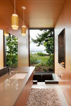 Modern Master Bathroom with can lights, Built-in bookshelf, Undermount sink, partial backsplash, three quarter bath, Bathtub