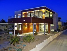 A Rare LEED Platinum-Certified each house has wood paneling, an outdoor patio space, terrace lifted on metal pilotis, metal railing, clean lines and high ceilings.
