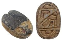 """Carved gray limestone scarab, the Egyptian symbol of resurrection, the bottom with Egyptian symbols including a bird. 18th Dynasty.  Size: ½""""  Date: 1570-1342 BC"""