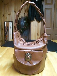 Brown hand made leather purse.