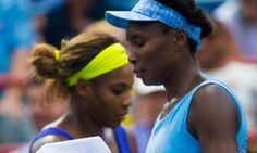 epa04347665 Venus Williams (R) of the US walks past  Serena Williams of the US during  their semi-final match at the Rogers Cup women tennis tournament in Montreal, Canada, 09 August 2014.  EPA/ANDRE PICHETTE