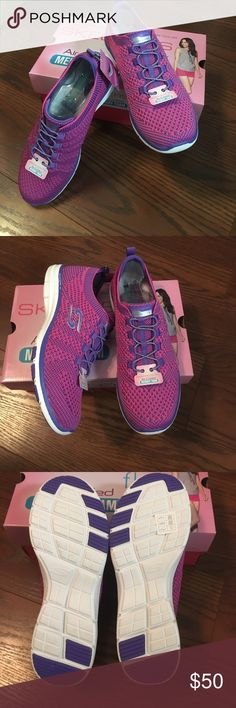 Skechers Galaxies Pink & Purple Slip on Shoes New in box. Beautiful two tone pink and purple Skechers with metallic bungee laces. I love the two tone design, but I wear an 8.5-9.5 in Skechers depending on the shoe and whether or not I wear socks, and these were just the tiniest bit too tight with socks. I'd say these run true to size 8.5. Skechers Shoes