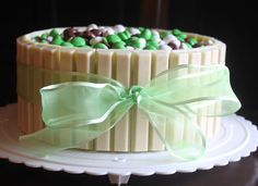 White Chocolate Kit Kat Cake- use pastel M&M's for easter... red and green for Christmas, etc.