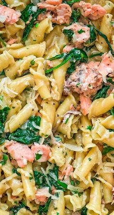 This Salmon Pasta with Spinach is a deliciously easy pasta recipe with chunks of tender salmon, spinach in a scrumptious creamy Parmesan sauce! #salmon #seafood #dinner #pasta