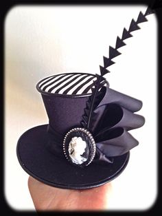 Black & White Cameo stripe mini top hat made by www.curiouserandcuriouser.net.au