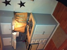 Camper remodel. I like the painted cabinets and the stars on the wall.