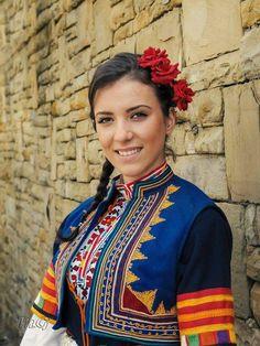Beautiful Bulgarian girl in traditional costume