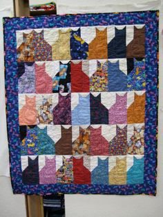 row cats cat quilt with fishie border I've always liked this pattern because it reminds me of old grain elevators ... I used to always see them when I was younger ... now they are almost all gone! :(