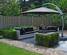 lovely garden seating area with clipped hedges and strong lines within the grass and gravel border