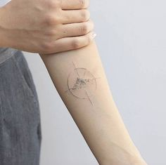 Sketch style single needle compass tattoo by Lindsay April