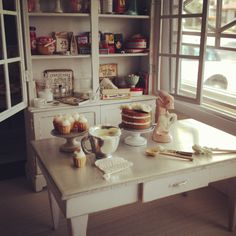 Frosting a cake and cupcakes by Kim Saulter. Vintage kitchen baking love....