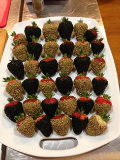 Chocolate dipped strawberries with black and gold sprinkles. roaring 20s