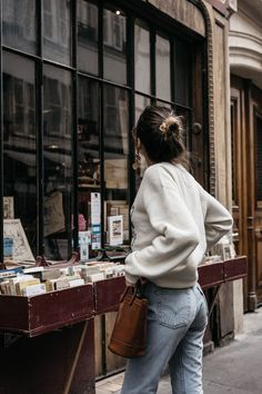 How to nail Parisian style with vintage Levi's 501 jeans stitched letters sweater trend and Moynat bucket bag outfit ideas