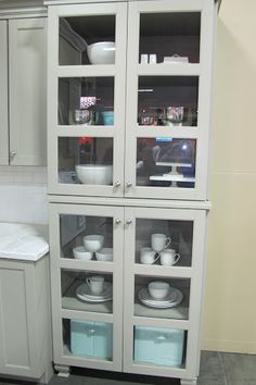 Stacking two cabinets makes a very handsome china cabinet.