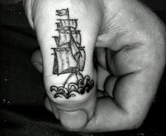 ship thumb knuckle tattoo. It's tiny and it's perfect I might get that!