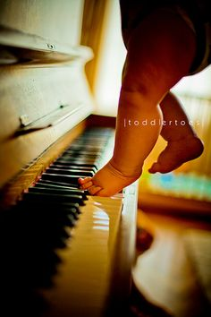 Baby Feet on the Keys... Cute detail shot. Maybe try something with her little fingers