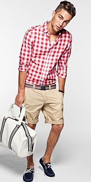 Shop this look on Lookastic:  http://lookastic.com/men/looks/long-sleeve-shirt-crew-neck-t-shirt-shorts-boat-shoes-duffle-bag/11659  — Red Gingham Long Sleeve Shirt  — White Crew-neck T-shirt  — Tan Shorts  — White and Black Canvas Duffle Bag  — Navy Suede Boat Shoes