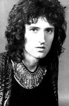Brian May. Played guitar in Queen. Has a PhD in astrophysics. Owner of glorious hair.