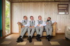 The groom and groomsmen get ready at a Straddie beach house Stradbroke Island Photography