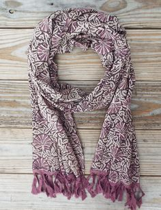 PurpleShellScarf: A light- weight and ethically made cotton scarf in purple, creme and black with a purpleshell block print and purplefringe.