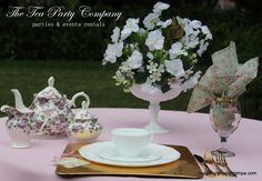 loving the look of milk glass flower centerpiece! Milk Glass Centerpieces, Square Gold Chargers, Matching Teapot Sets Whaite Collection China, Glassware, Silverware. All for rent  @ The Tea Party Company