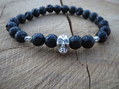 Check out this item in my Etsy shop https://www.etsy.com/listing/235822226/tribal-mens-black-lava-stones-skull