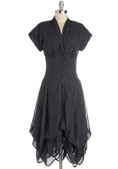 Black & white-swiss dot chiffon fully-lined shirt-dress with short set-in cuffed sleeves; self narrow shawl-collar neckline; short bodice w/ bust gathers & rear sweetheart seam; 8-panel princess-seamed gored skirt bustled to below-the-knee w/ fitted empire waist & 5 front black buttons. 100% polyester (chiffon) lined in cotton, from ModCloth, $124.99
