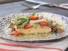 Lemon Citrus Cod with Vegetables Recipe from Food Network. Steam vegetables first. Try with salmon and asparagus and shallots or tilapia with red pepper strips and pea pods.