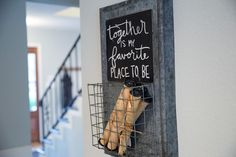 As always, Joanna incorporates distinctive decorative touches like this message board with basket hung between the kitchen and living room.