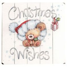 """Paneled wood wall decor with a teddy bear design and text detail.  Product: Wall decorConstruction Material: WoodDimensions: 13"""" H x 13"""" WCleaning and Care: Wipe with a damp cloth"""