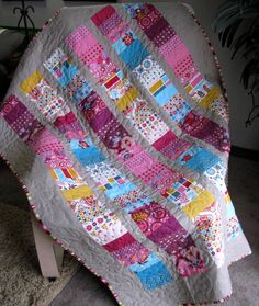 Love the colors of this quilt. (Domestic Bliss Charm Pack) Lots of cute quilts on this blog.