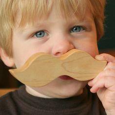 kid with wooden mustache