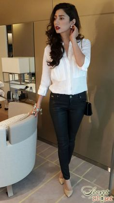 White top on dark skin and dark hair.  Accessorized with a bracelet, earrings and shoes.