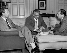 Author Graham Greene with David O. Selznick and director Carol Reed over the script of The Third Man, 1949.