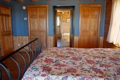 Bedroom in a Hybrid constructed log home.  See more at www.wardcedarloghomes.com