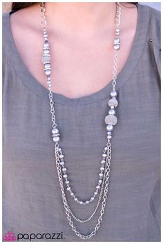 A stunning collection of mesh wire beads in assorted sizes and brilliant silver beads are strung along a group of silver chains.  Sold as one individual necklace. Includes one pair of matching earrings.