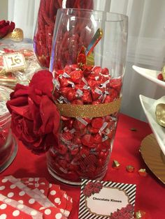 Chocolate kisses at a Red, white, and gold Quinceañera birthday party! See more party ideas at CatchMyParty.com!