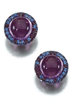 PAIR OF AMETHYST AND SAPPHIRE EAR CLIPS, ELKE BERR Each centring on a cabochon amethyst within a border of circular-cut sapphires of various tints, clip fittings, signed Elke Berr, French import marks