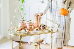 How to Easily Bring Thanksgiving Décor into Every Room Pier 1 review fall - bar cart decor with copper pitcher Pier1