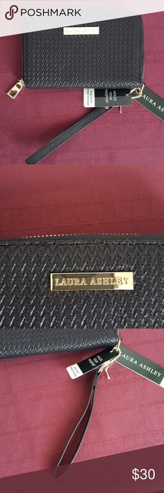 Laura Ashley En Route Travel & Passport Wallet Has one ID slot and 5 credit card slots, along with a money slot on one side in the interior, and a passport holder on the other interior side. Zipper back, and zipper closure. Has removable wrist holder. Woven pattern. Fabric. Any questions, feel free to ask! Laura Ashley Bags Wallets