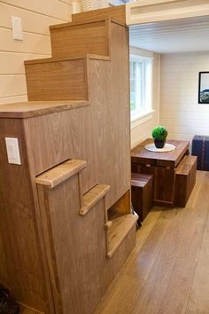 A beautiful 220 sq ft craftsman home from Tiny Heirloom. The space featres automated stairs and beautiful wood accents throughout the home!