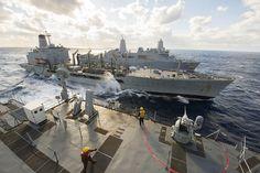 MEDITERRANEAN SEA (Jan. 9, 2015) The Whidbey Island-class amphibious dock landing ship USS Fort McHenry (LSD 43), front, and the San Antonio-class amphibious transport dock USS New York (LPD 21), rear, conduct an underway replenishment with the Henry J. Kaiser-class fleet replenishment oiler USNS Kanawha (T-AO-196) Jan. 9, 2015.