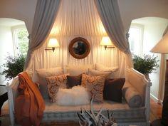 Pretty canopy over the sofa. So inviting and romantic!
