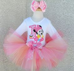 Sweet Pink Baby Minnie Mouse Cupcake Birthday Tutu Set I wish I got this for my daughter on her first birthday because it fits the theme :)