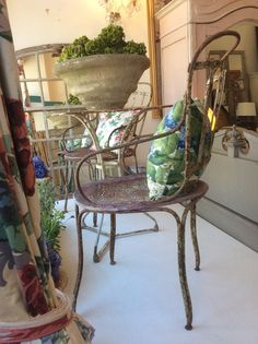 Today's display window with 1850s chairs and with decorative cushions.@Susan Osbourne. Sold